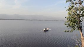 Boating on the lake. Video of a man boating on Rawal Lake Islamabad Pakistan stock video footage