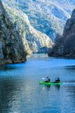 Boating on Matka Lake between the Rocky Mountains royalty free stock photos