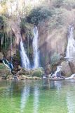 Boating near the waterfall. Peoples in hollyday boating near a beautyfull waterfall in summer Stock Image