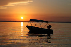 Boating Paradise. Leisure boat at sunrise waiting for the holiday to begin stock photography