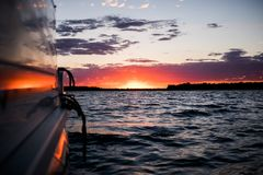 Boating on the peaceful lake at sunset royalty free stock photography
