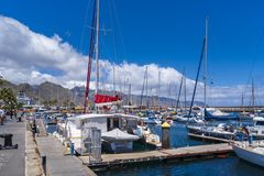 Boating port with larger sailboats lying in front of Santa Cruz de Tenerife. Tenerife, Spain - May 1 2019: Boating port with larger sailboats lying in front of royalty free stock photography
