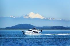 Boating on Puget Sound under Mt Baker Stock Photography