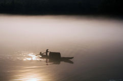 Boating in quiet lake Royalty Free Stock Image
