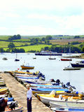 Boating on the river Dart. The Jetty and moorings At Stoke Gabriel, Devon, with the river Dart ferry in the background Stock Photo