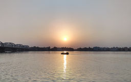 Boating in river Ganga during sunset Stock Photography