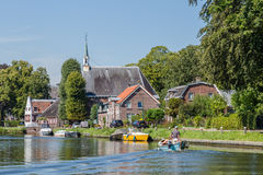 Boating on the river Vecht along the church of Zuilen near Utrec Stock Images