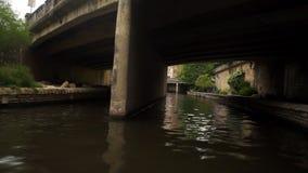 Boating through River Walk in San Antonio, Texas. Boating through the San Antonio River along the River Walk in Texas stock footage