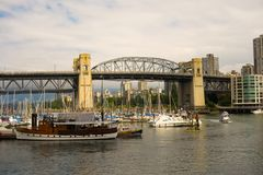 The boating scene at vancouver`s port. Motorboats and yachts as seen on the pacific coast of british columbia royalty free stock photography