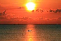 Boating at sunrise Stock Photo