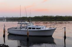 Boating, waiting at dawn on the peaceful Myola stock photography