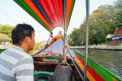 Boatman in bright boat Royalty Free Stock Images