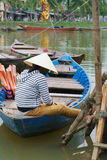 Boatman with Conical hats in Vietnam Royalty Free Stock Images