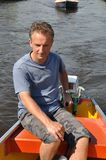 Boatman  at the helm Royalty Free Stock Photos