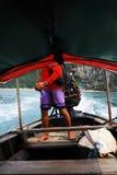 Boatman. Navigating his longtail boat (South of Thailand Royalty Free Stock Photos