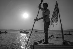Burmese Boatman - Irrawaddy River - Myanmar. Boatman on an old riverboat at sunrise on the Irrawaddy River (Ayeyarwaddy River) in Myanmar (Burma).  It is the Stock Photos