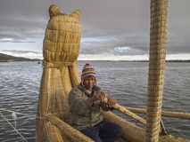 Boatman and Totora reed boat Royalty Free Stock Image