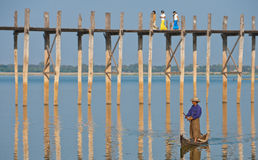 Boatman by ubein bridge. A man in a canoe on the taungthaman lake by The 1,5 km long ubein teak bridge in Amarapura, central Myanmar Royalty Free Stock Photography