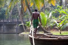 Boatman in the wooden boat Royalty Free Stock Images