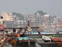 Boatmen Assi Ghat Varanasi India. A typical day on the ghat in Varanasi, India, on the bank of the Ganges River. Boatmen wait for tourists to ride the river royalty free stock photo
