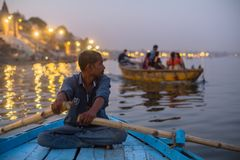 Boatmen on the Ganga river at night. VARANASI, INDIA - MAR 13, 2018: Boatmen on the Ganga river at night. Varanasi is one of the most important pilgrimage sites Stock Image
