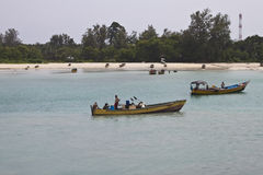 Boatmen in traditional boats Stock Photos