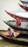Boatmen waiting passengers on Ganges river in Varanasi, India Stock Photos