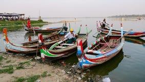 Boatmen waiting for passengers on lake in Mandalay, Myanmar Royalty Free Stock Photo