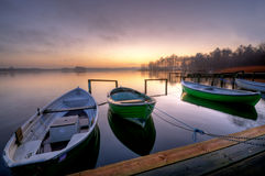 Boats. Both an early morning at sunrise and foggy weather Royalty Free Stock Photography