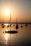 Boats. On the sunset lake Stock Photography