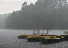 Boats. By the lake in the rain Royalty Free Stock Photo