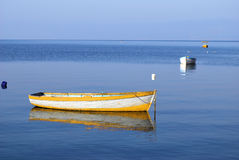Boats. Fishing boats on a still water Royalty Free Stock Photography