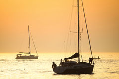 Boats in Adriatic sea at sunset Stock Images