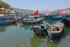Boats afloat. Lots of fishing boats at a fishing village island a few miles off the coast of Vietnam royalty free stock image