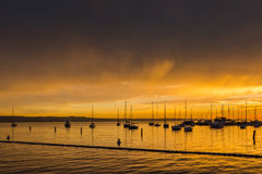 Boats against sunset. Royalty Free Stock Photos