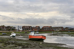 Boats aground at Emsworth, Hampshire. View of old boats aground at low tide time in the touristic sea village royalty free stock image