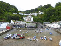 Boats aground in harbour. Fishing vessels aground at low tide in the small harbour at Clovelly in north Devon, England stock image