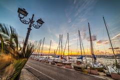 Boats in Alghero harbor at dusk. Italy Stock Images