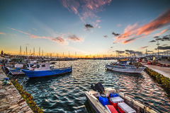 Boats in Alghero harbor at dusk. Boats in Alghero harbor at sunset, Sardinia Royalty Free Stock Photos