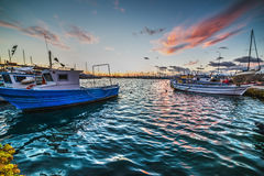 Boats in Alghero harbor at sunset Royalty Free Stock Image