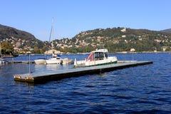 Boats along the coast in Lenno, Como lake, Italy. Beautiful touristic place Stock Photos