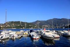 Boats along the coast in Lenno, Como lake, Italy. Beautiful touristic place Stock Photo