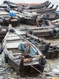 Boats along a polluted seaside in Myanmar Royalty Free Stock Images