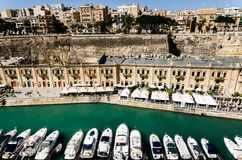 Boats along waterfront of Valletta, Malta Stock Image