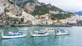 Boats in Amalfi. Amalfi, the capital of the Amalfi coast with small ferry boats in the little harbour stock photography