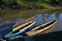 Boats at the Amazon river, Peru. Typical fisherman boats at the peruvian Amazon jungle royalty free stock photos