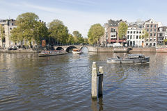 Boats on amstel and herengracht in amsterdam Stock Photo