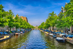 Boats on Amstel river in Amsterdam, Holland, Netherlands, HDR Royalty Free Stock Image