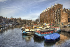Boats in Amsterdam Canal, Holland Royalty Free Stock Photo