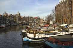 Boats in Amsterdam Canal, Holland Royalty Free Stock Photos